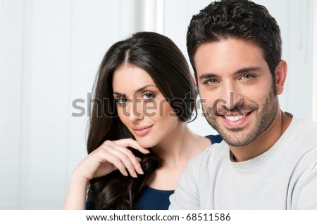 Happy smiling couple looking together at camera - stock photo
