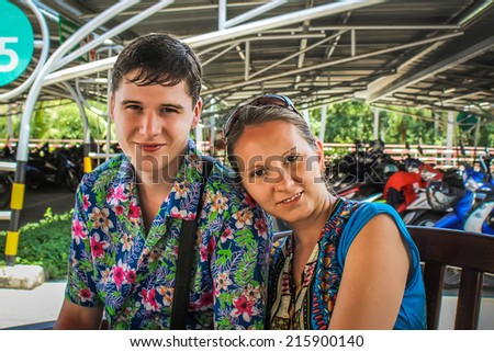Happy Smiling Couple near motorbike parking place - stock photo