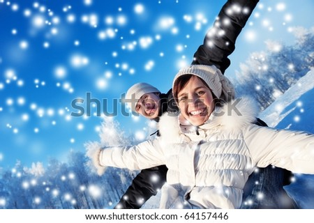 Happy smiling couple on a winter background - stock photo