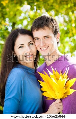 Happy smiling couple outdoors - stock photo