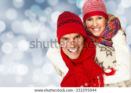 Happy smiling couple over sparkle christmas background. - stock photo