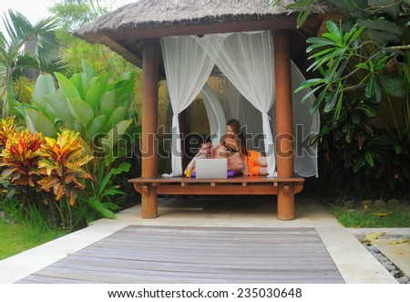 Happy smiling couple surfing internet  and enjoy the summer - stock photo