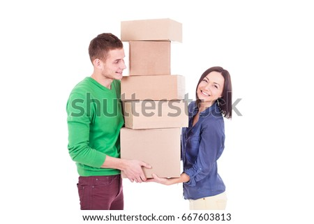 Happy smiling delivery man and woman carrying boxes isolated on white background. Couple have shopping order