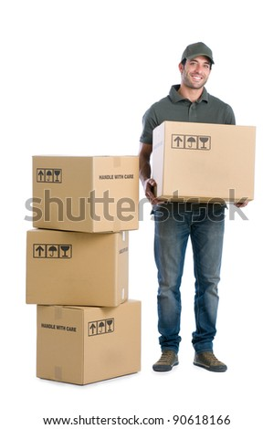 Happy smiling delivery man carrying boxes isolated on white background - stock photo