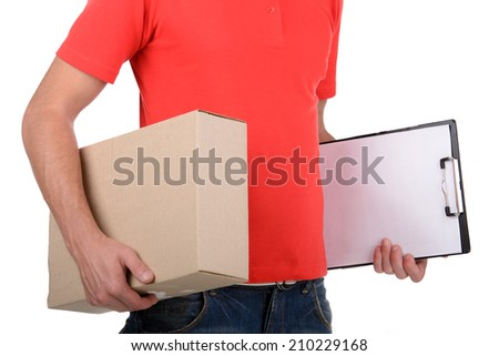 Happy smiling delivery man signing papers for delivery. isolated on white background - stock photo