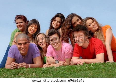 happy smiling diverse race group of teenagers - stock photo
