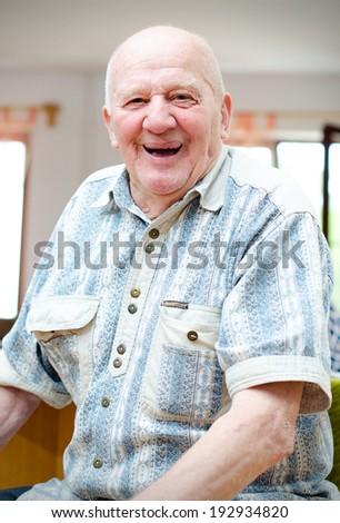Happy smiling elder senior man - stock photo