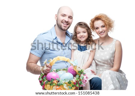 happy smiling family holding basket - stock photo