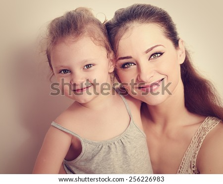 Happy smiling family. Mother and daughter. Instagram effect portrait. Closeup