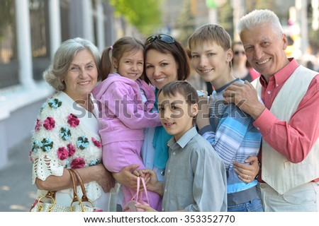 Happy smiling family relaxing in summer city - stock photo