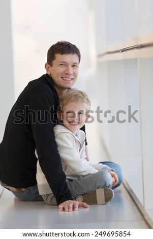happy smiling family waiting at the airport terminal - stock photo