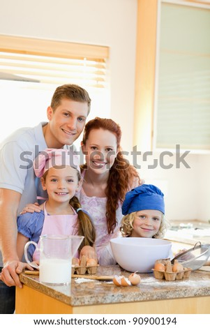 Happy smiling family with baking ingredients
