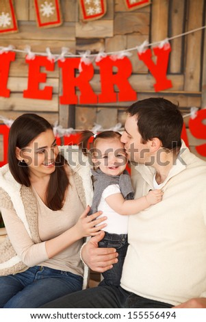 Happy smiling family with near the Christmas background - stock photo