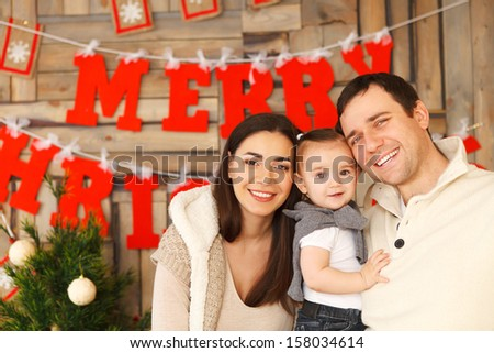 Happy smiling family with near the Christmas background