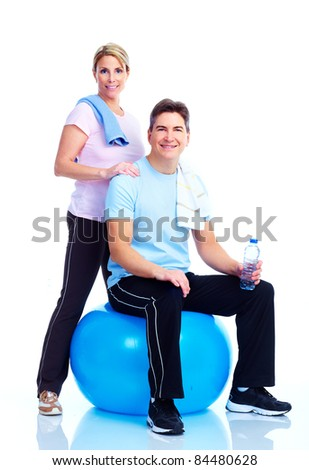 Happy smiling Fitness  couple. Over white background - stock photo