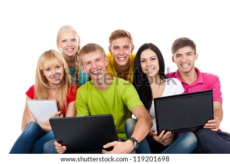 Happy smiling friends, group of young people standing and embracing together isolated on white background - stock photo
