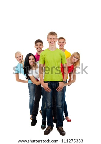 Happy smiling friends, group of young people standing in row full length portrait isolated on white background