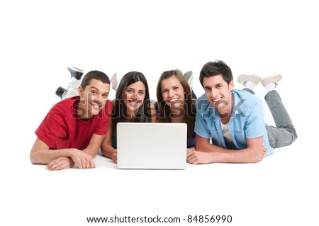 Happy smiling friends working together at laptop computer isolated on white background