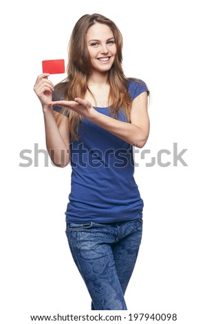 Happy smiling girl in casual clothing, showing blank credit card, on white background