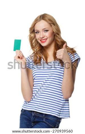 Happy smiling girl showing blank credit card and gesturing thumb up, on white background! - stock photo