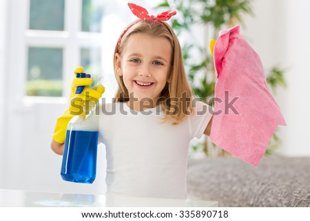 Happy smiling girl successful doing housework obligations - stock photo
