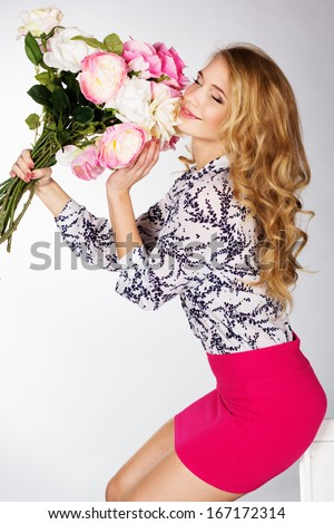 happy smiling girl with bouquet of  roses - stock photo