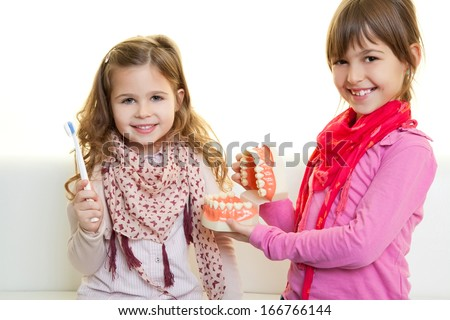 Happy smiling girsl with tooth brush  - stock photo