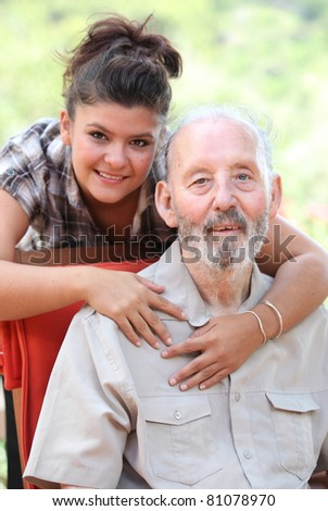 Happy smiling grandad or grandpa together with grandaughter - stock photo