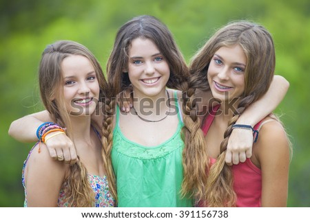 happy smiling group of  teenage girls with white teeth - stock photo