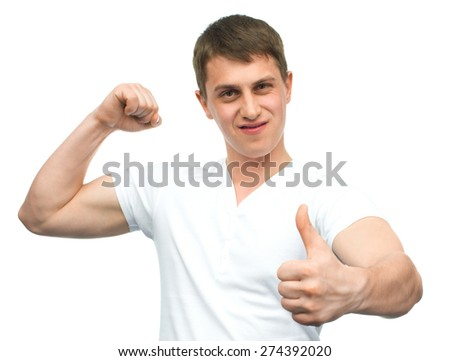 Happy smiling guy showing thumb up hand sign isolated on white background - stock photo