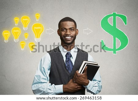 Happy, smiling handsome man holding books has ideas ready for financial success isolated on black grey wall background. Positive human facial expression feeling, emotion. Education economics concept - stock photo