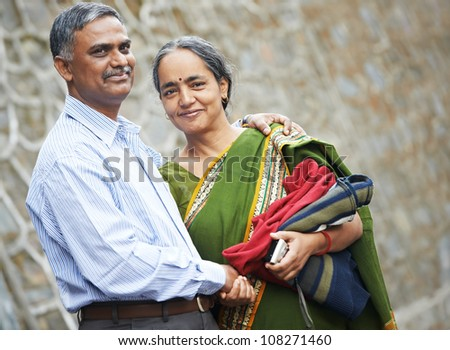 Happy Smiling indian adult people couple outdoors - stock photo