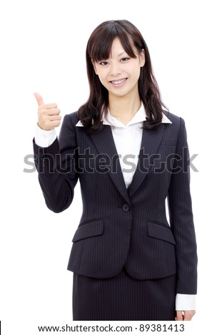 Happy smiling japanese business woman with thumbs up gesture