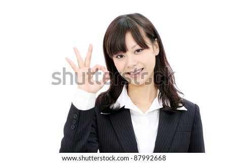 Happy smiling japanese businesswoman with okay gesture - stock photo