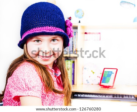 Happy smiling little girl with hat
