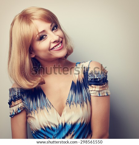 Happy smiling makeup woman with blond short hair style looking. Closeup toned portrait - stock photo