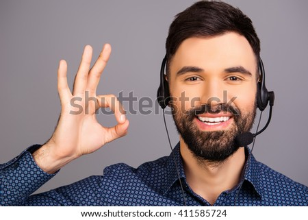 "Happy smiling man in head-phones gesturing ""LIKE"" - stock photo"