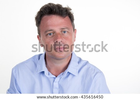 Happy smiling man looking at camera with satisfaction, with copy space, isolated