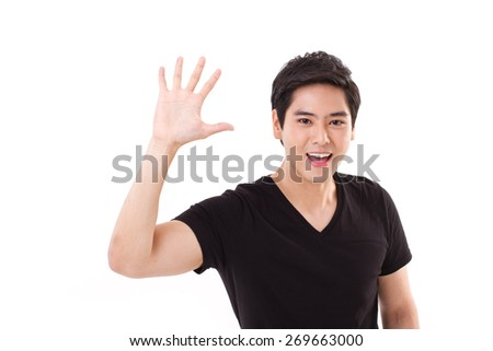 happy smiling man showing greeting gesture, showing his palm to you - stock photo