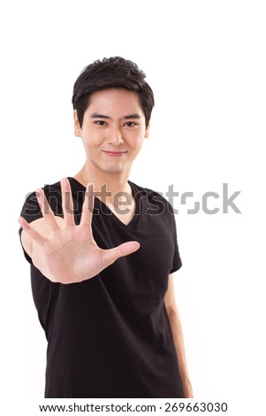 happy smiling man showing his 5 fingers or palm to you - stock photo