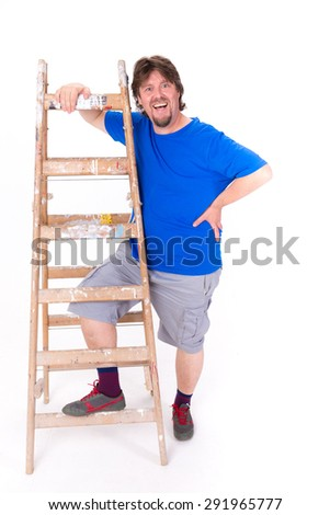 Happy smiling man standing next to a ladder isolated on a white background