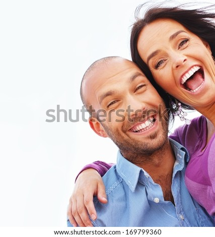 Happy smiling middle-aged couple outdoors - stock photo