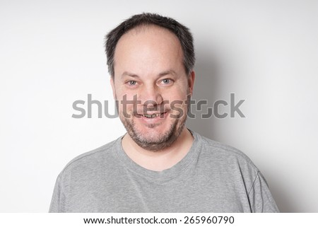happy smiling middle aged man in his forties       - stock photo