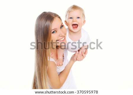 Happy smiling mother and baby having fun on white background - stock photo