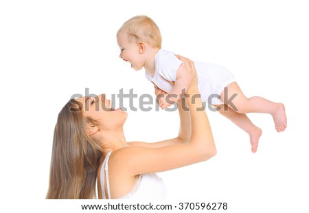 Happy smiling mother and baby playing on a white background - stock photo