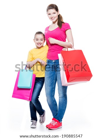 Happy smiling mother and daughter with shopping bags - isolated on white background.