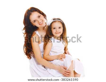 Happy smiling mother and little child daughter on white background - stock photo