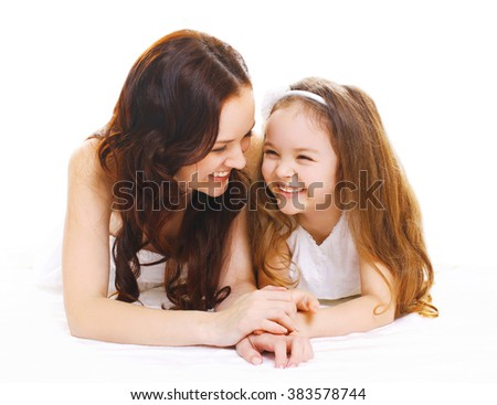 Happy smiling mother with little child daughter on white - stock photo