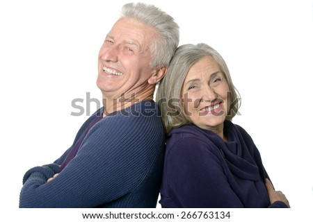 Happy smiling old couple on white background - stock photo