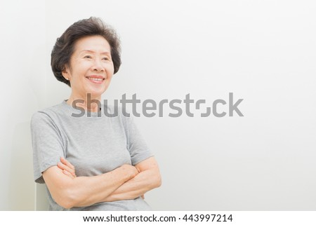 happy  smiling old Woman Portrait  with text space. - stock photo